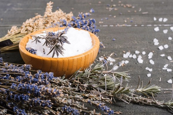 dried lavender on the counter with Epsom salts in a bamboo bowl