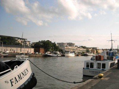Boats along the Aura River in Turku, Finland