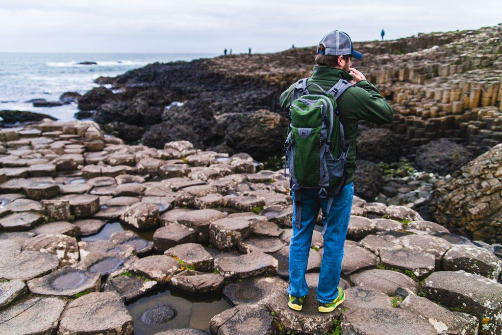 man taking picture giants causeway