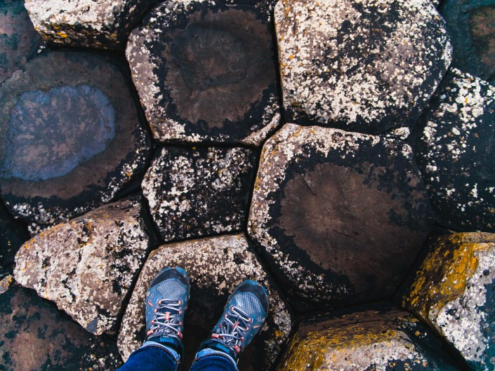 feet looking down at rock formation