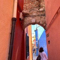 Quaint arches and beautiful colors along the little alleyways throughout the town.