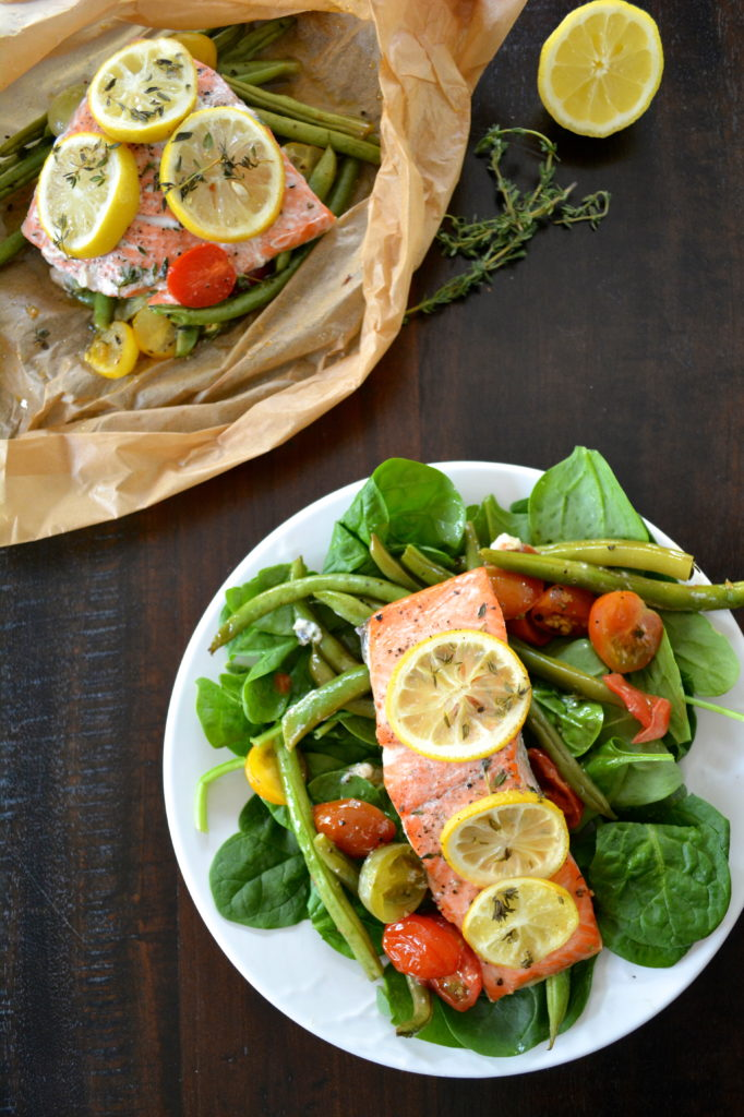 Salmon en Papillote - salmon cooked in parchment paper with vegetables over salad