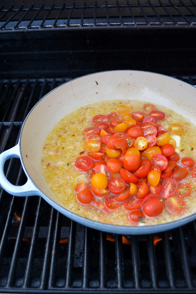Easy Grilled Mussels à la Marinière - sauteeing white wine, butter, shallots, and tomatoes