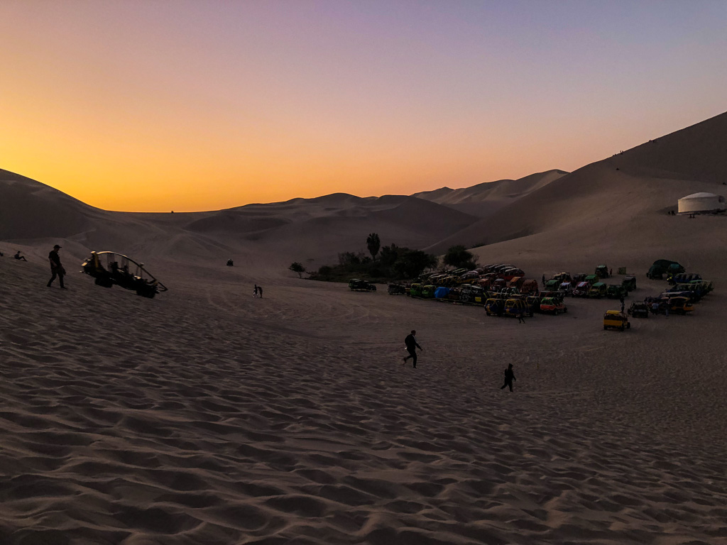 Dune buggies waiting for passengers in Huacachina, Peru
