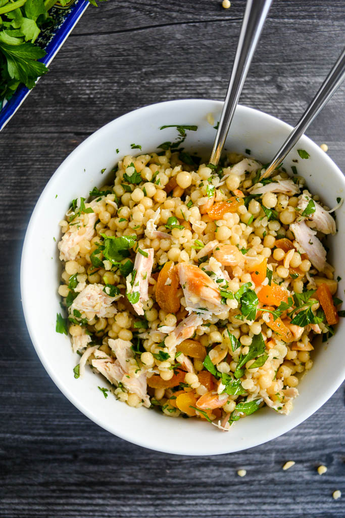 Pearl couscous mixed with rotisserie chicken, dried apricots, marcona almonds, and fresh herbs