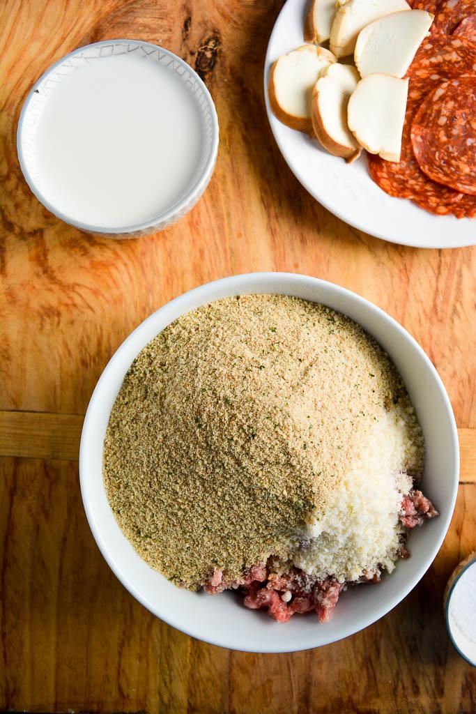 Ground beef, ground pork, breadcrumbs, parmesan cheese, and milk