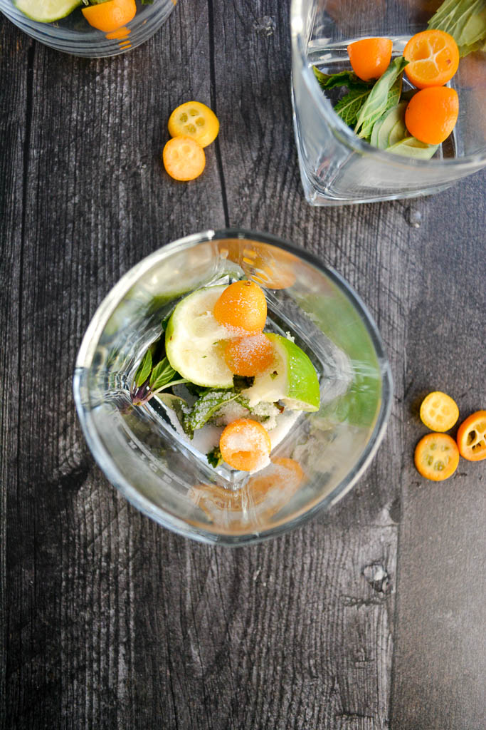 Lime, Thai Basil, and Kumquats muddled with white sugar