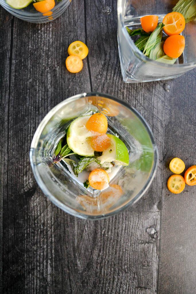 Lime, Thai Basil, and Kumquats muddled with white sugar