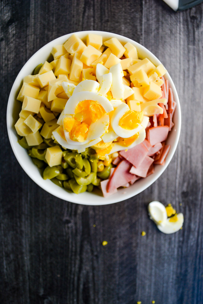 Brown rice, cherry tomatoes, corn, olives, ham, emmentaler cheese, and hard boiled eggs