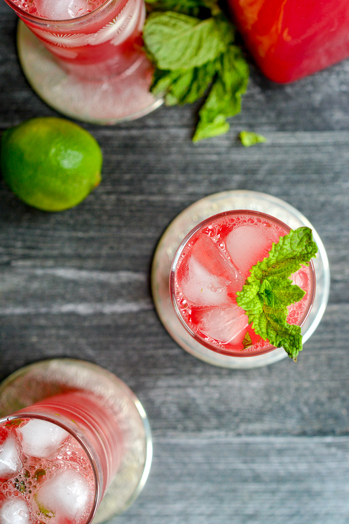 Glass of fresh watermelon spritzer with mint sprig