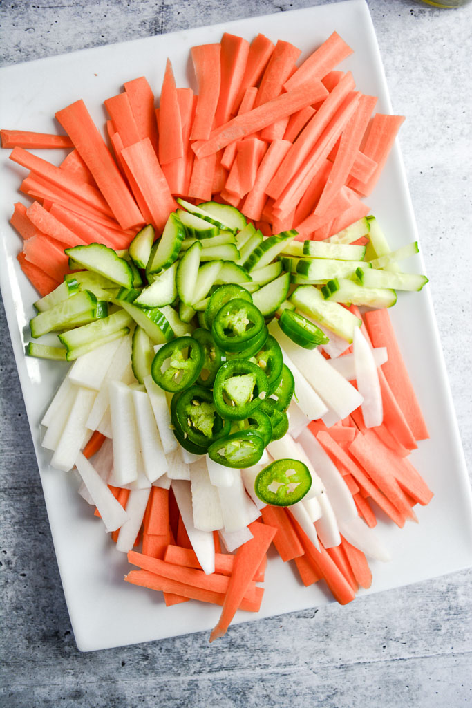 Matchtsticked carrots, daikon radish, and cucumber, and sliced jalapenos