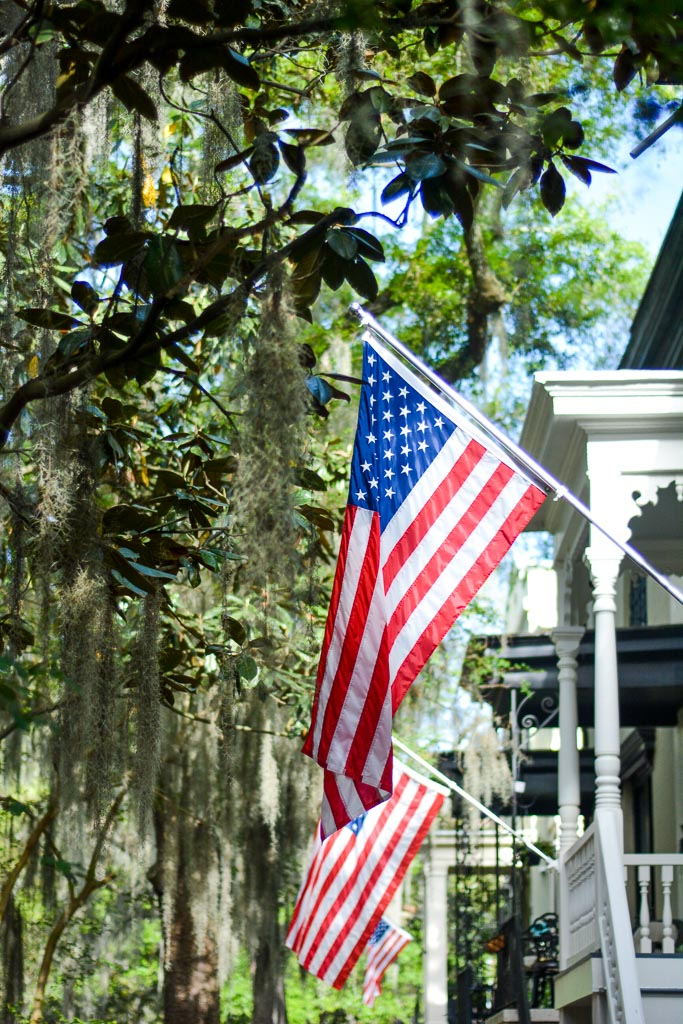 Spanish moss, American flags, and old Savannah porches