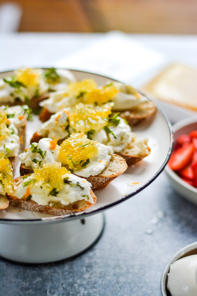 Burrata toasts with honeycomb, mint, and orange zest