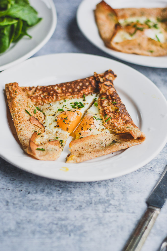 Savory breakfast crepe with runny baked egg