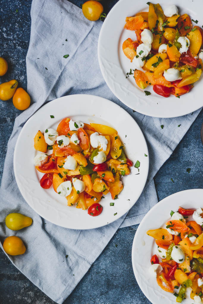 Marinated peach and tomato salad with garden tomatoes and fresh mozzarella