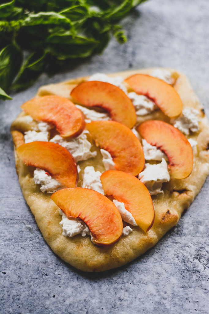 Pizza Crust with Olive Oil, Burrata, and sliced Peaches
