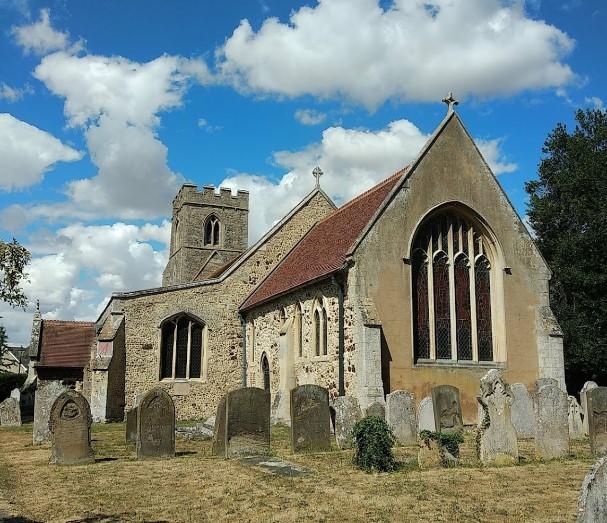 graves at saint andrews church in oakington England.