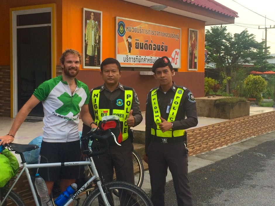 Cycle touring Highway police booth Thailand