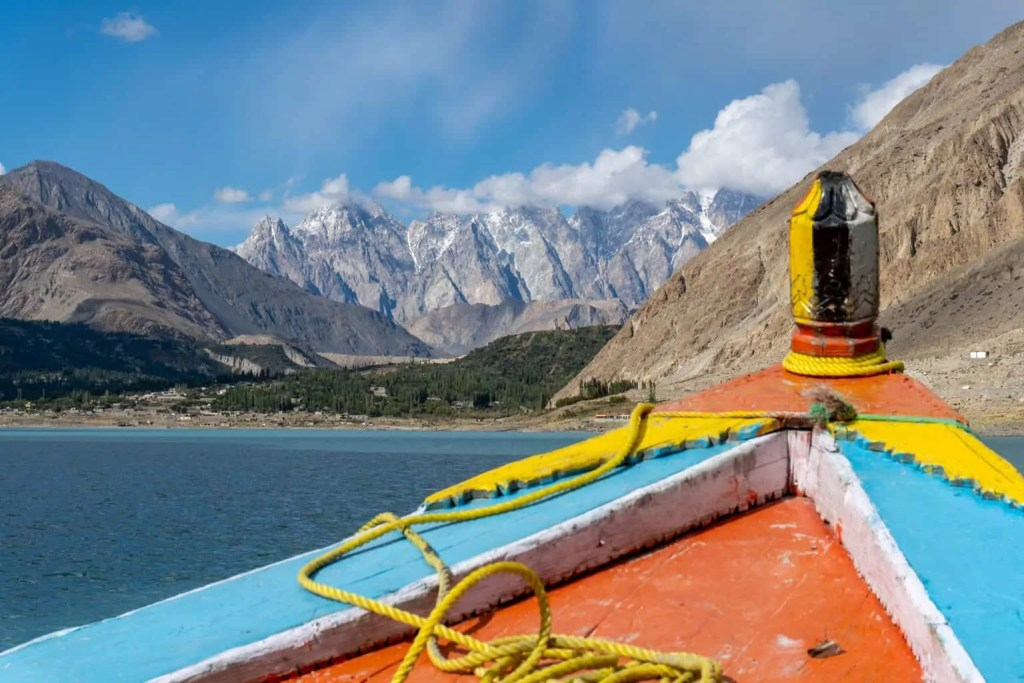 Taking a boat ride on Attabad lake during a visit to Pkistan
