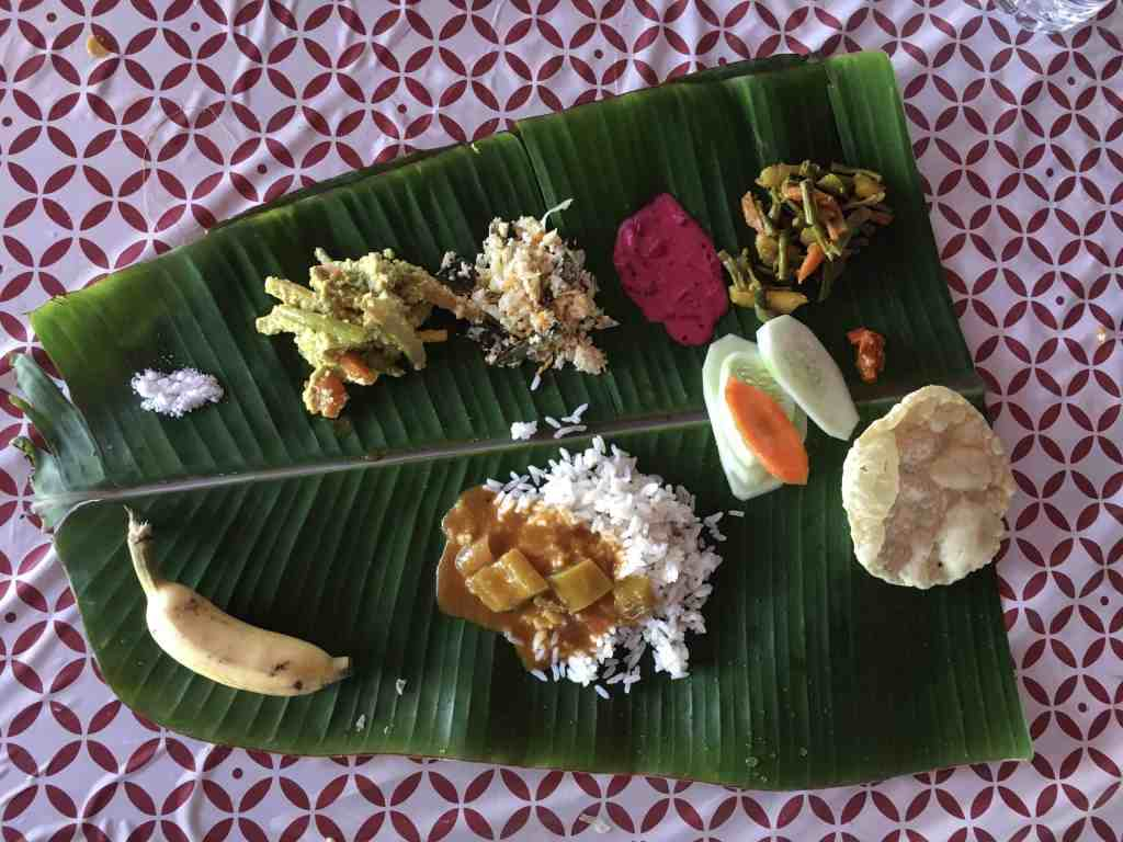 Traditional food served on a banana leaf. Knowing to eat with your right hand is part of the india survival guide