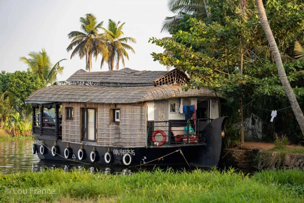 A houseboat tour in the Kerala backwaters is a relaxing Indian experience