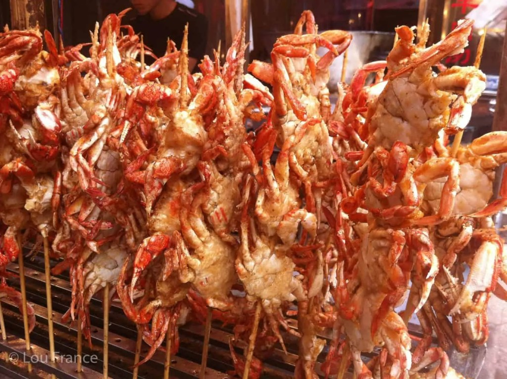 Crab on a stick is a strange street food in China