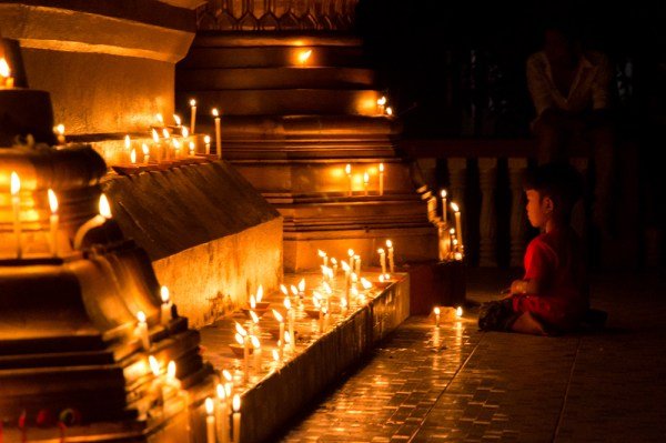 Child at a candle-lit pagoda, 1,000 Lights Festival, Myanmar by Wandering Wheatleys