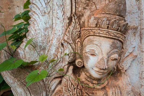Temple wall carving in Myanmar by Wandering Wheatleys