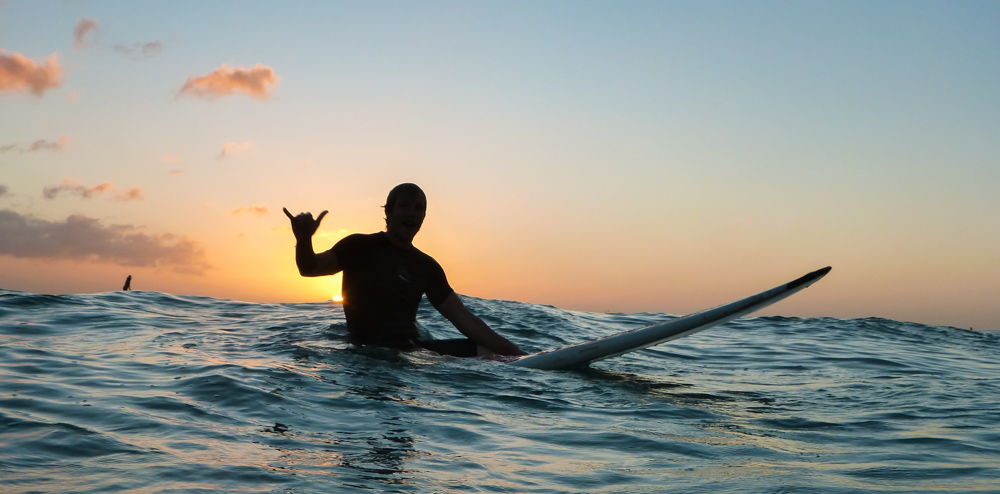 Surfing at Sunset in Waikiki, Oahu, Hawaii by Wandering Wheatleys