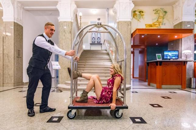 riding in a luggage cart at the Grand Hotel Union in Ljubljana