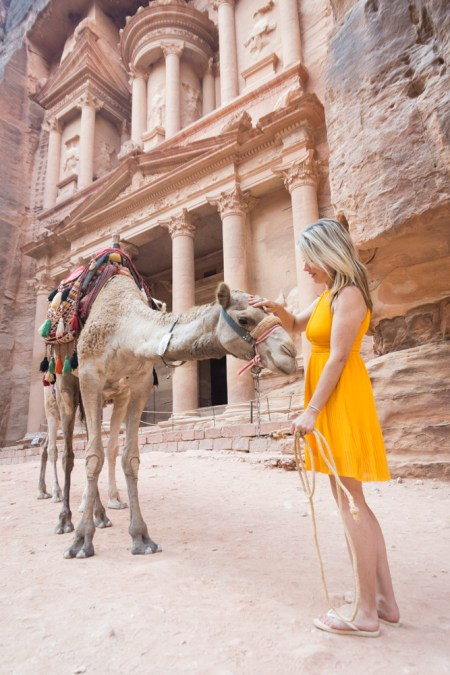 Petting a camel at the Treaury, Petra, Jordan by Wandering Wheatleys