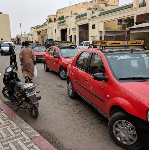 Red Petite Taxis in Fes, Morocco by Wandering Wheatleys