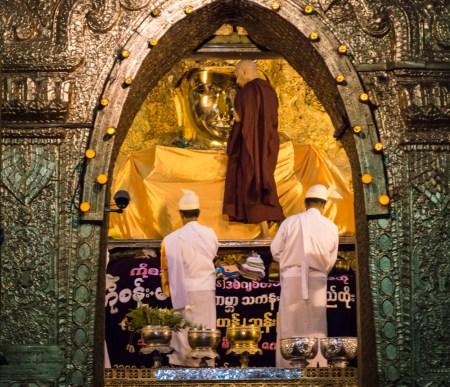 Buddha Face Cleaning Maha Myat Muni Pagoda, Mandalay, Myanmar by Wandering Wheatleys
