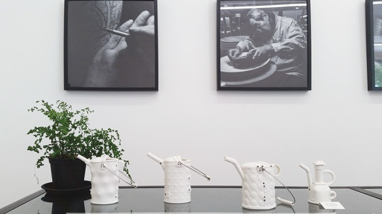 Elegant tea pot with black and white photographs