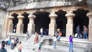 People on the stairs of the entrance to Elephanta Caves