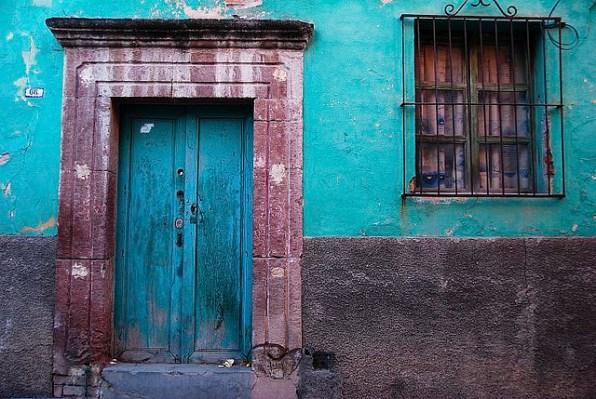 Rustic colorful door in the town of San Miguel de Allende, Mexic