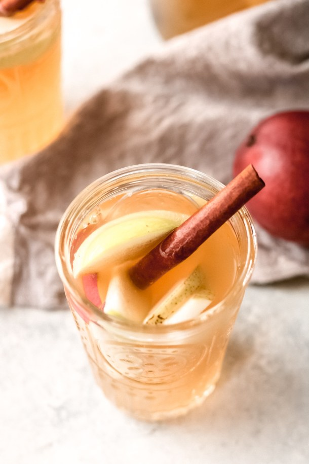 a glass of apple cider sangria