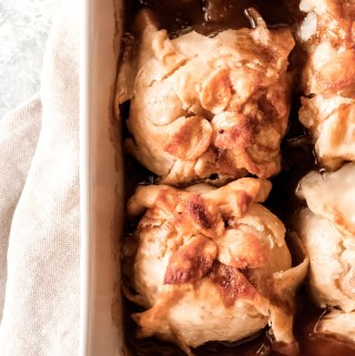 3 baked apple dumplings in a baking dish