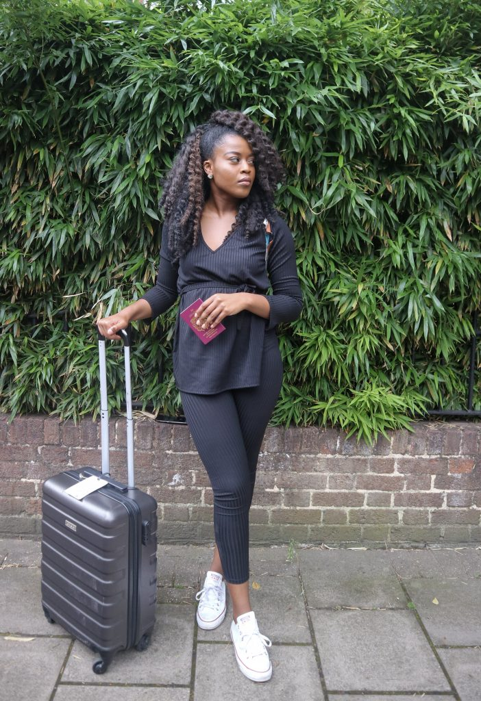 Wearing the Femme Luxe Black Ribbed Belted Loungewear Set