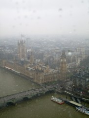 Riding the Eye with a view of Parliament