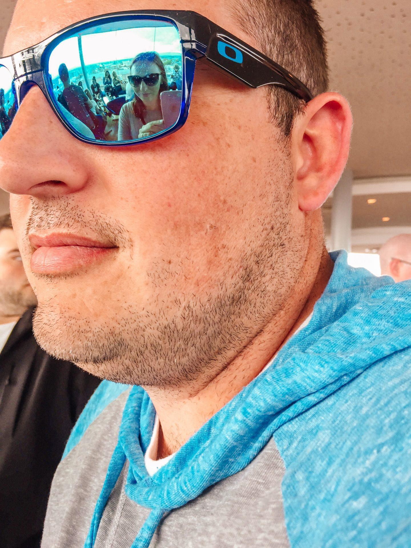 Reflection of woman at beer bar in her husband's sunglasses. Gravity Bar Guinness Storehouse Dublin Ireland. European Beer Travel.