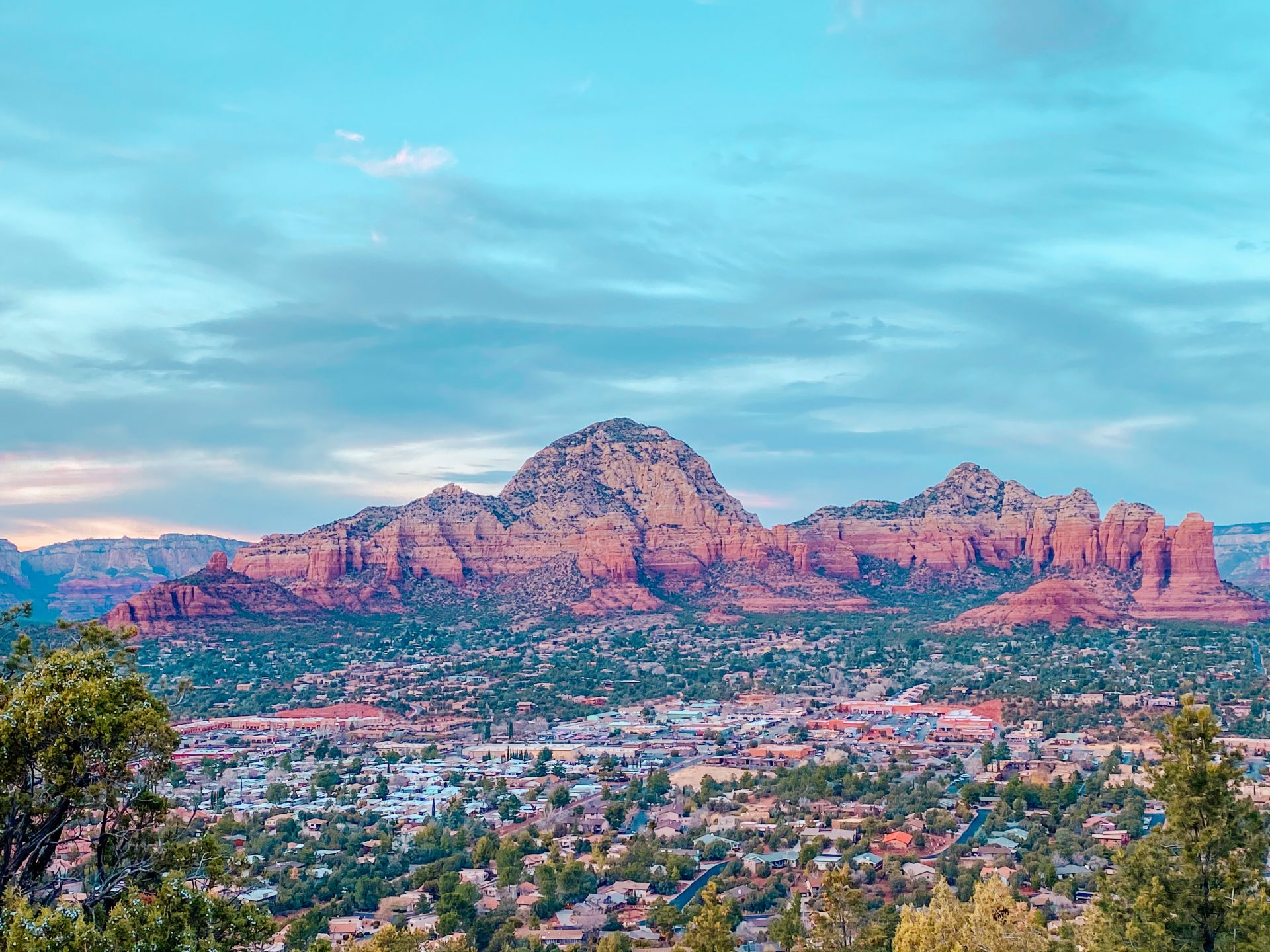 View out over Sedona Arizona close to sunset. View of the city and red rocks in the distance as the light is dwindling.