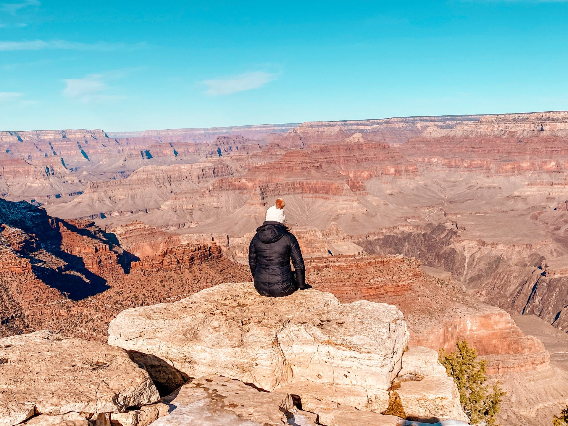 Woman looking out into the vastness of the Grand Canyon in Arizona.