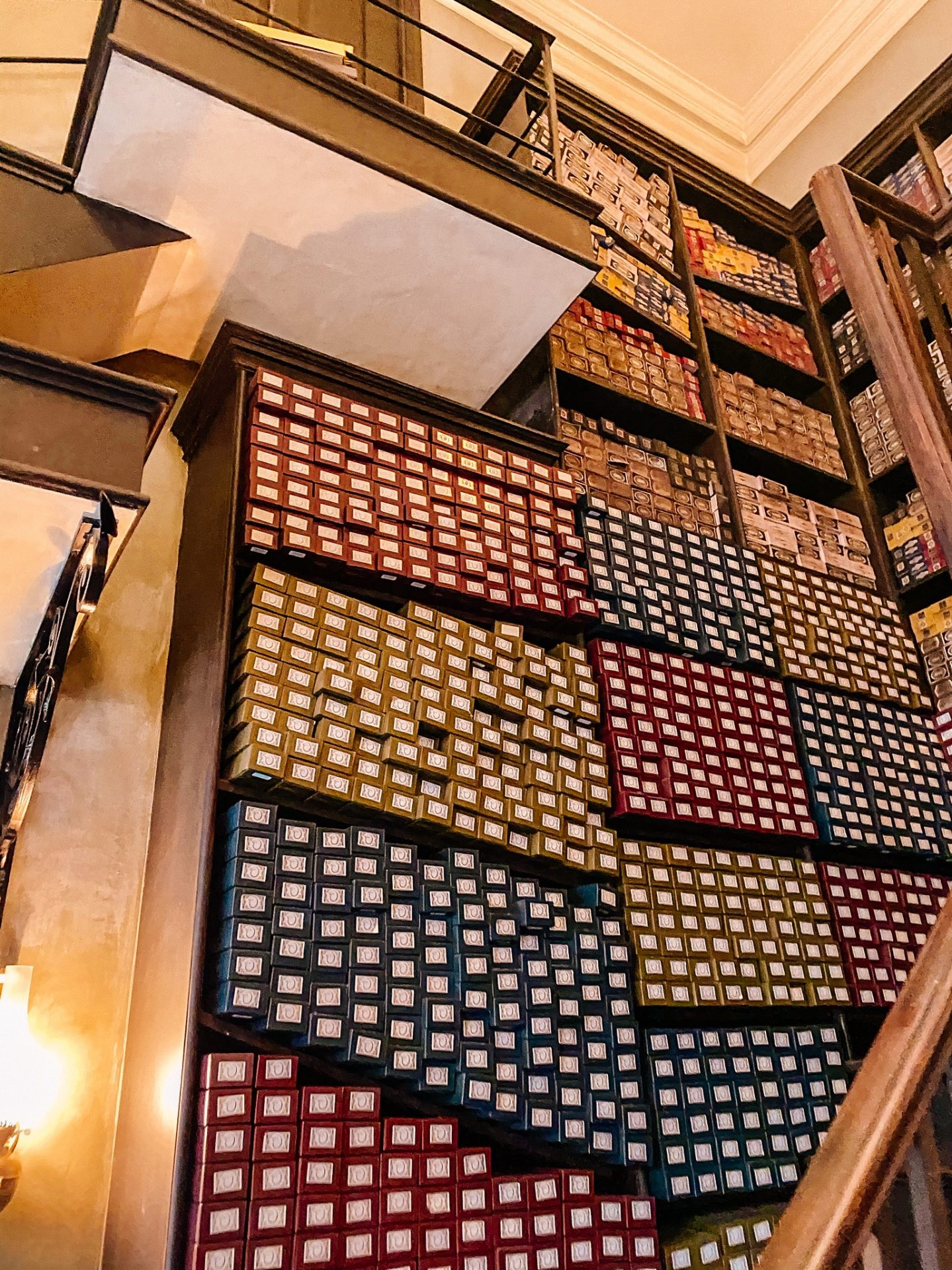 Ollivanders wand shop at the Wizarding World of Harry Potter at Universal Orlando Studios Florida shelves up to the ceiling of wands.