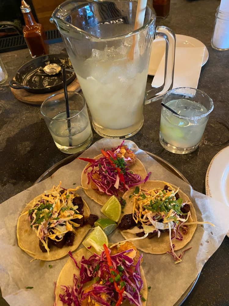 A pitcher of margaritas and street tacos at bakersfield in nashville tennessee