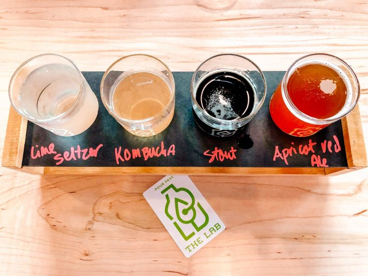 flight of seltzers, kombucha and beer at the lab pilot brewing facility located in st. paul minnesota during a brewery crawl