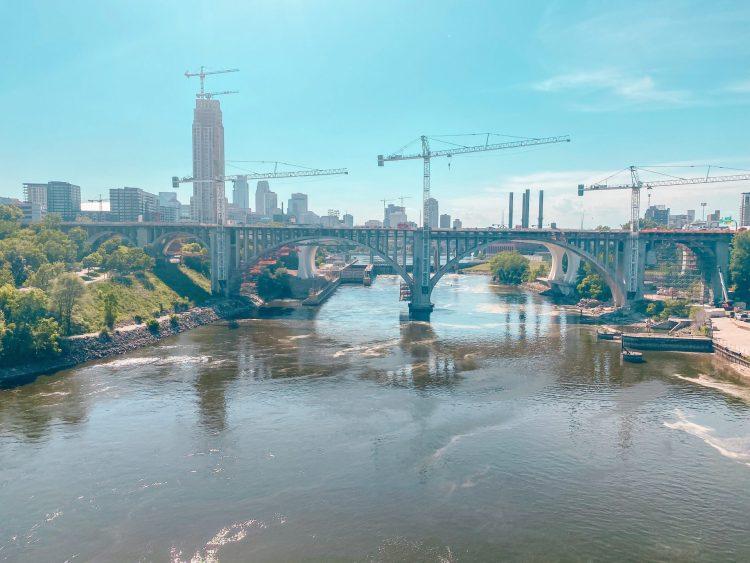 Pedestrian bridge near University of Minnesota (U of M) over the Mississippi River looking toward downtowwn Minneapolis