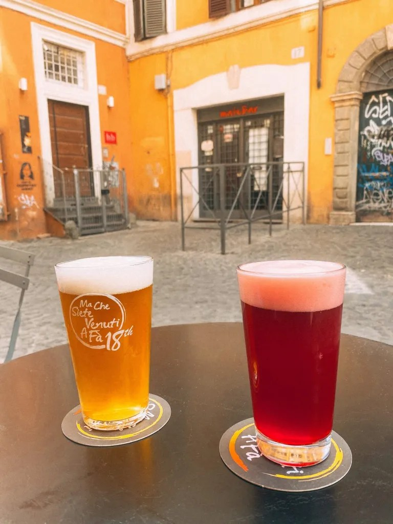 Beers sitting on a table outside of a beer bar in Rome Italy