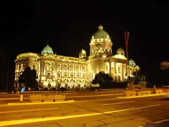 Belgrade's Parliament lights up the night sky. American in Belgrade