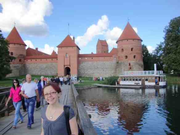 Bell in front of the Trakai castle in Lithuania